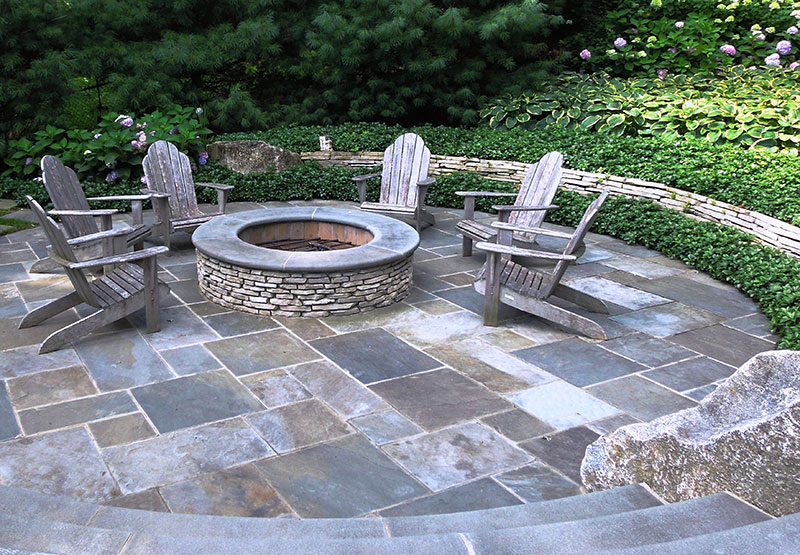 Dimensional flagstone mortared in place offers a formal look.