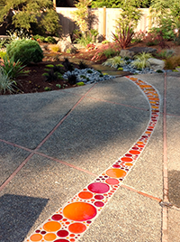 Recycled glass disks create movement and to lead the eye through the patio space.