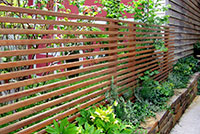 Privacy screen supports vertical plant material