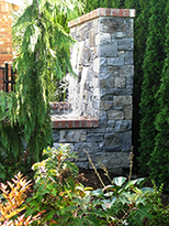 Water Feature by Vanessa Gardner  Nagel - Side view of new stone and brick-trimmed water feature