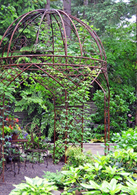 The owner added this gazebo to the woodland creating a destination not far from the new koi pond.